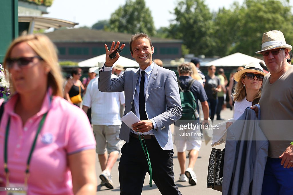 Ross Hutchins waves as he walks through the crowd ahead of the Gentlemen's Singles final match between Andy Murray of Great Britain and Novak Djokovic of Serbia on day thirteen of the Wimbledon Lawn Tennis Championships at the All England Lawn Tennis and Croquet Club on July 7, 2013 in London, England.
