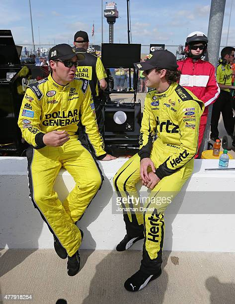Ross Kenseth driver of the Dollar General Toyota and Ryan Blaney driver of the Hertz Ford chat before qualifying for the NASCAR XFINITY Owens Corning...