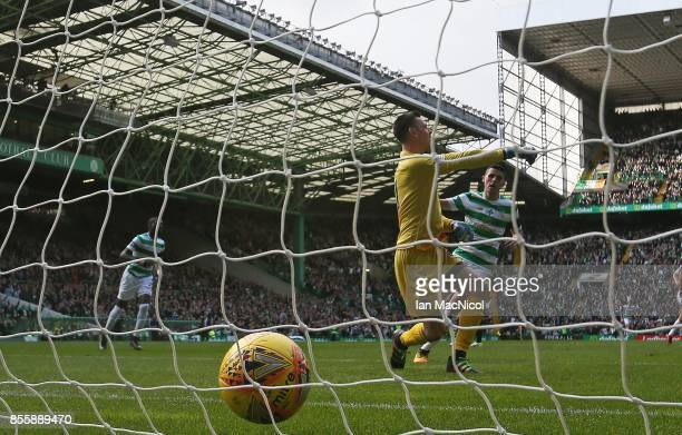 Ross Laidlaw of Hibernian is seen as Tomas Rogic of Celtic looks on after Callum McGregor of Celtic scores the opening goal during the Ladbrokes...