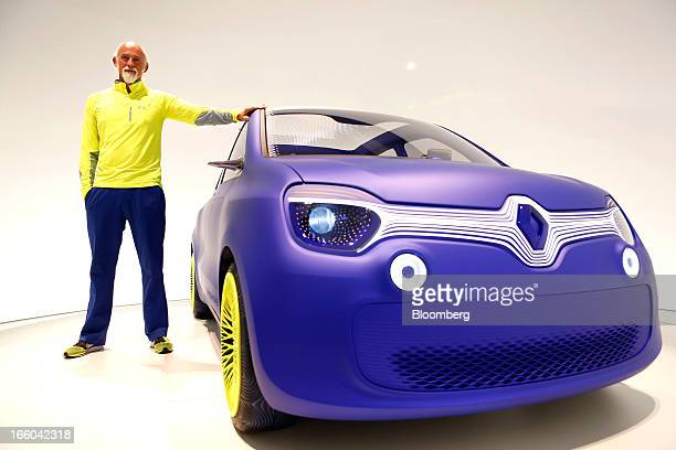 Ross Lovegrove a British designer stands alongside the Renault Twin'Z concept automobile designed by Lovegrove for the French car manufacturer...