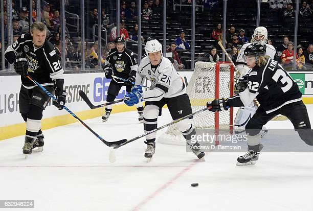 Ross Lynch and Peter Stastny of Team Lemieux vie for the puck with Borje Salming of Team Gretzky during the 2017 NHL AllStar Celebrity Shootout at...