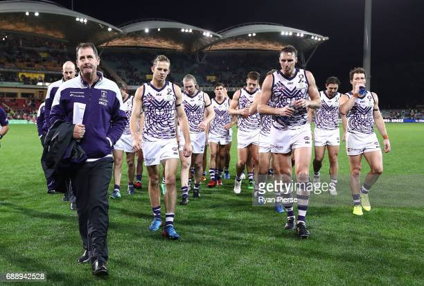 Ross Lyon coach of the Dockers and Nat Fyfe of the Dockers lead their team from the ground after the round 10 AFL match between the Adelaide Crows...
