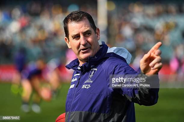 Ross Lyon coach of the Dockers looks for the wind direction during the 2016 AFL Round 20 match between the Fremantle Dockers and the West Coast...