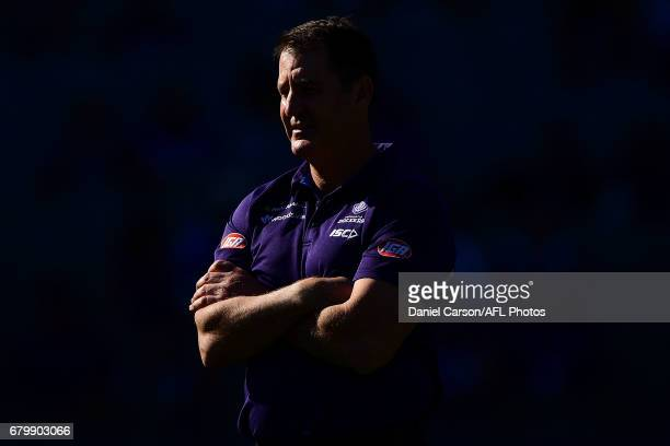 Ross Lyon coach of the Dockers looks on at warm up during the 2017 AFL round 07 match between the Fremantle Dockers and the Essendon Bombers at...