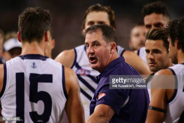 Ross Lyon Senior Coach of the Dockers addresses the players at the quarter time break during the round six AFL match between the West Coast Eagles...