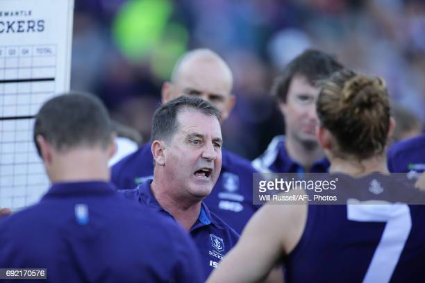 Ross Lyon Senior Coach of the Dockers addresses the players at the quarter time break during the round 11 AFL match between the Fremantle Dockers and...