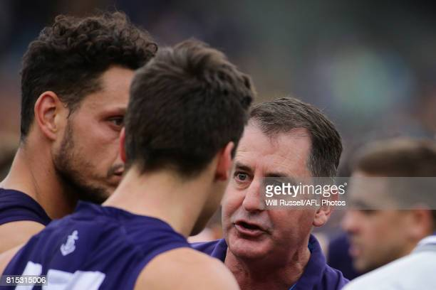 Ross Lyon Senior Coach of the Dockers addresses the players at the quarter time break during the round 17 AFL match between the Fremantle Dockers and...
