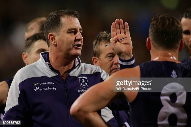 Ross Lyon Senior Coach of the Dockers addresses the players at the three quarter time break during the round 18 AFL match between the Fremantle...