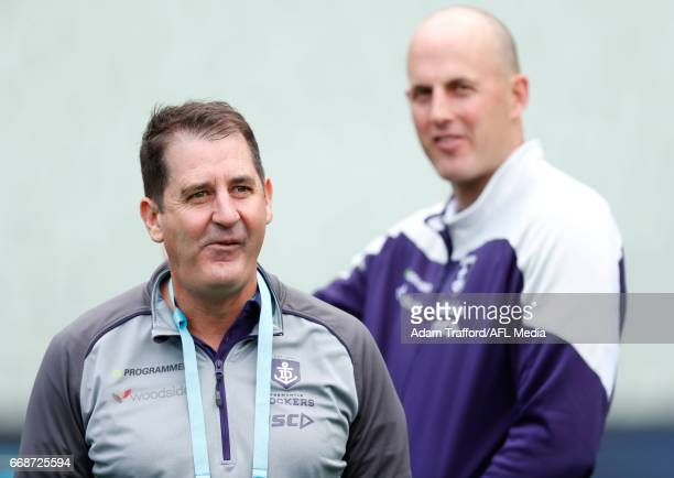 Ross Lyon Senior Coach of the Dockers chats to David Hale Development/Specialist Coach of the Dockers during the 2017 AFL round 04 match between the...