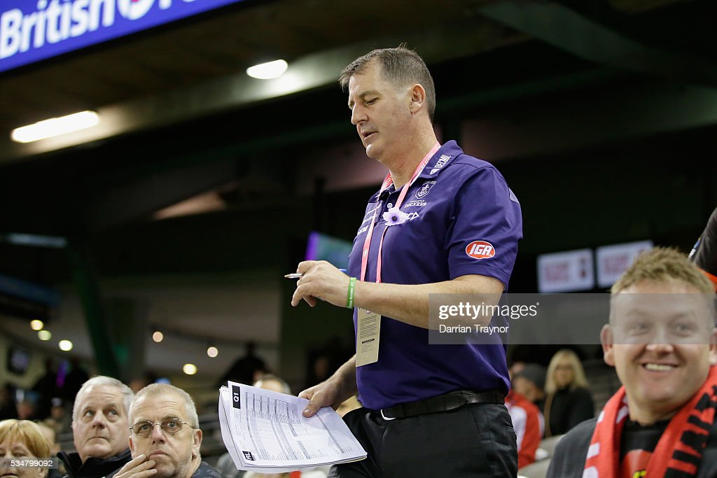 Ross Lyon, Senior Coach of the Dockers walks through the crowd to the 1/4 time huddle during the round 10 AFL match between the St Kilda Saints and the Fremantle Dockers at Etihad Stadium on May 28, 2016 in Melbourne, Australia.