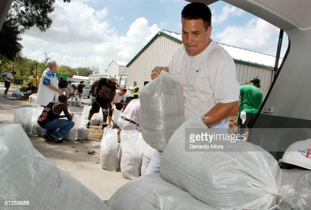 Ross Manfred loads sandbags in preparation for Hurricane Frances September 3 2004 in Orlando Florida Hurricane Francis a category 3 hurricane is...