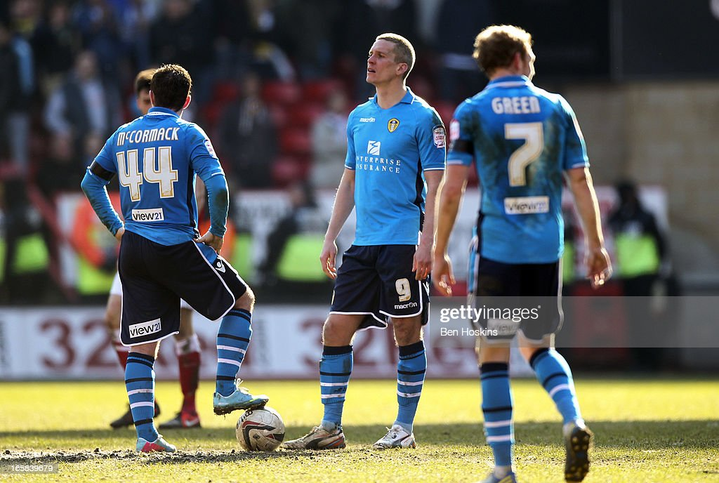 Ross McCormack (L) and Steve Morrison (C) look dejected after conceding a late equaliser during the npower Championship match between Charlton Athletic and Leeds United at the Valley on April 06, 2013 in London, England.