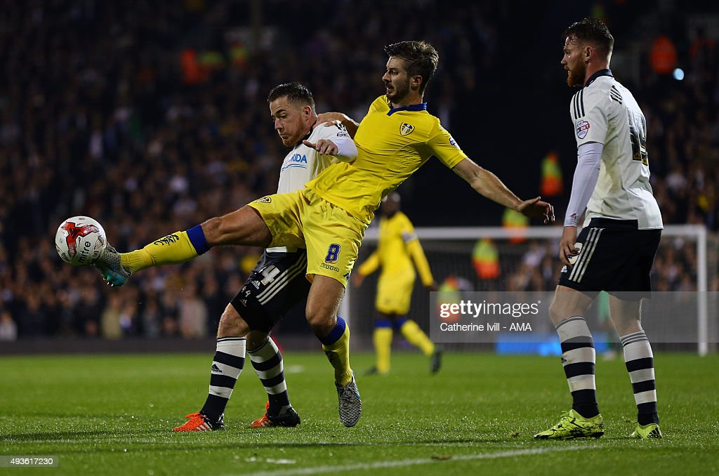 Ross McCormack of Fulham and Luke Murphy of Leeds United during the Sky Bet Championship match between Fulham and Leeds United at Craven Cottage on October 21, 2015 in London, England.