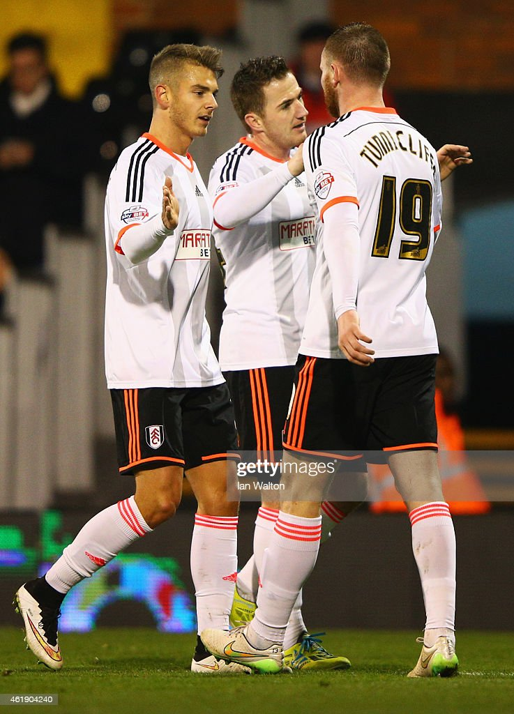 <a gi-track='captionPersonalityLinkClicked' href=/galleries/search?phrase=Ross+McCormack+-+Soccer+Player&family=editorial&specificpeople=13496004 ng-click='$event.stopPropagation()'>Ross McCormack</a> of Fulham (C) celebrates with Alex Kacaniklic (L) and <a gi-track='captionPersonalityLinkClicked' href=/galleries/search?phrase=Ryan+Tunnicliffe&family=editorial&specificpeople=5848106 ng-click='$event.stopPropagation()'>Ryan Tunnicliffe</a> (R) as he scores their second goal during the Sky Bet Championship match between Fulham and Nottingham Forest at Craven Cottage on January 21, 2015 in London, England.