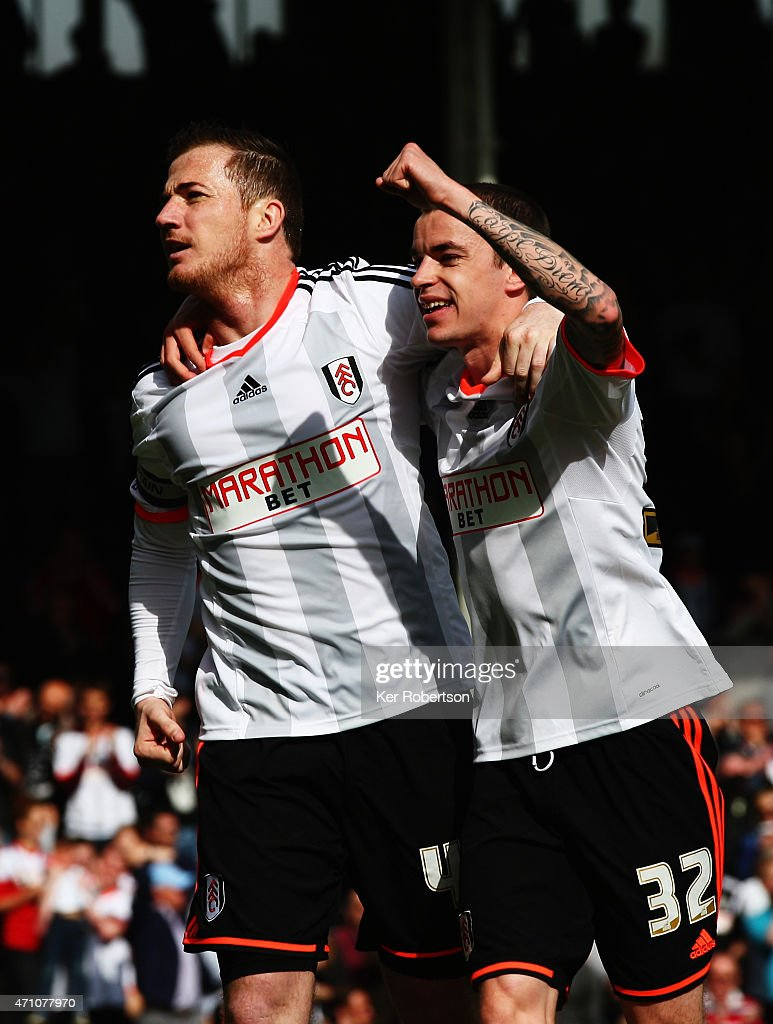 Ross McCormack of Fulham celebrates with team mate Sean Kavanagh after scoring his sides second goal from the penalty spot during the Sky Bet Championship match between Fulham and Middlesbrough at Craven Cottage on April 25, 2015 in London, England.