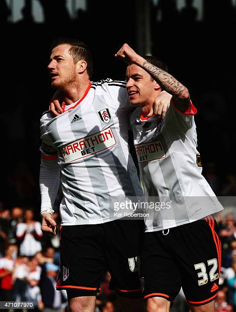 Ross McCormack of Fulham celebrates with team mate Sean Kavanagh after scoring his sides second goal from the penalty spot during the Sky Bet...