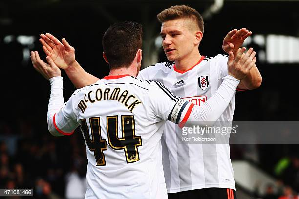 Ross McCormack of Fulham celebrates with team mate Shaun Hutchinson after scoring his sides third goal from the penalty spot during the Sky Bet...