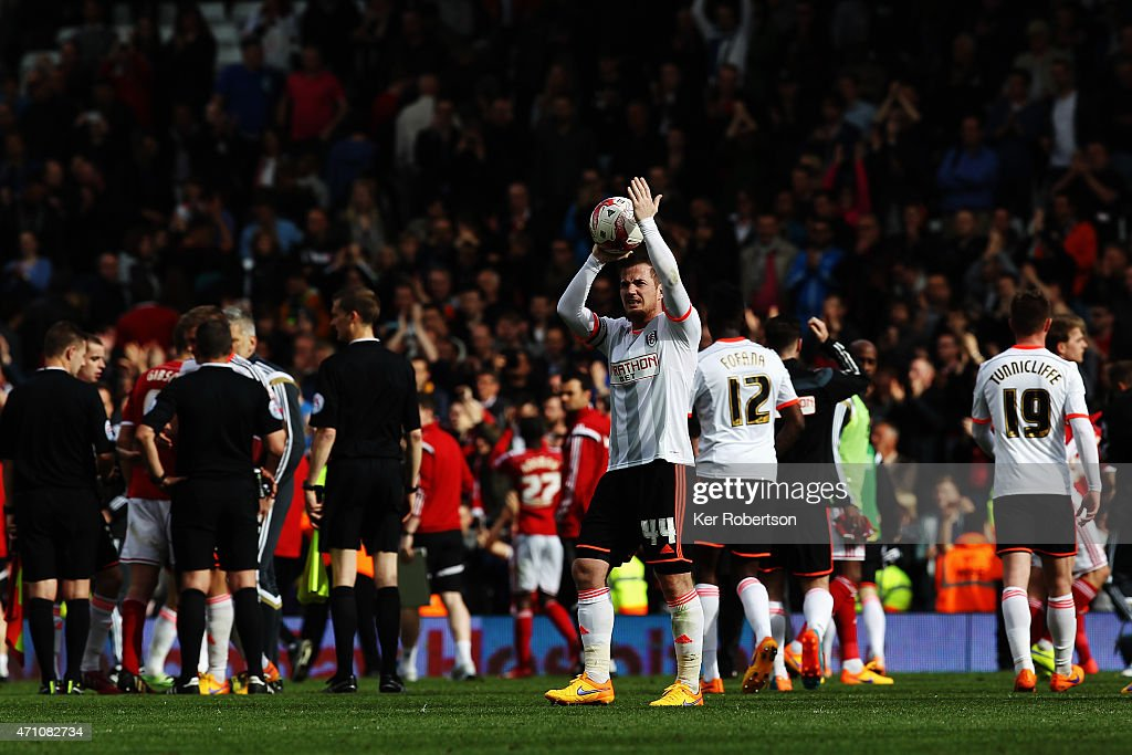 Ross McCormack of Fulham celebrates with the match ball after scoring a hat-trick during the Sky Bet Championship match between Fulham and Middlesbrough at Craven Cottage on April 25, 2015 in London, Engl)and.