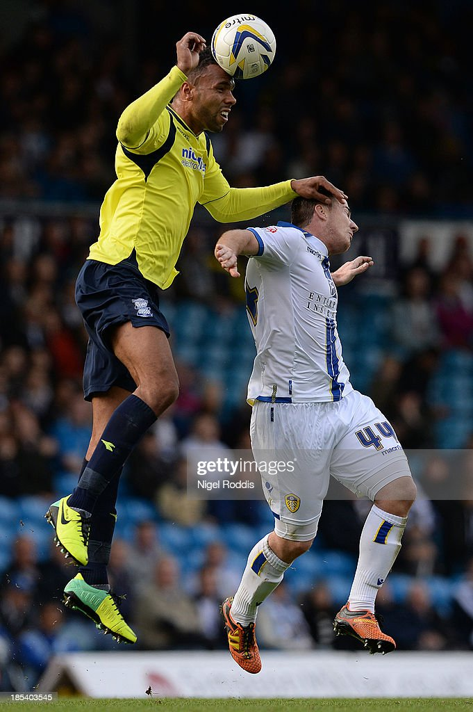 Ross McCormack (R) of Leeds United challenged by Kyle Bartley of Birmingham City during their Sky Bet Championship match between Leeds United and Birmingham City at Elland Road Stadium on October 20, 2013 in Leeds, England.