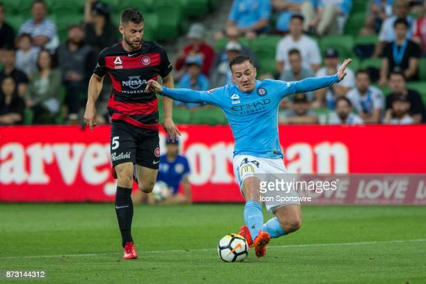 Ross McCormack of Melbourne City dives to try and control the ball in front of Brendan Hamill of the Western Sydney Wanderers during Round 6 of the...
