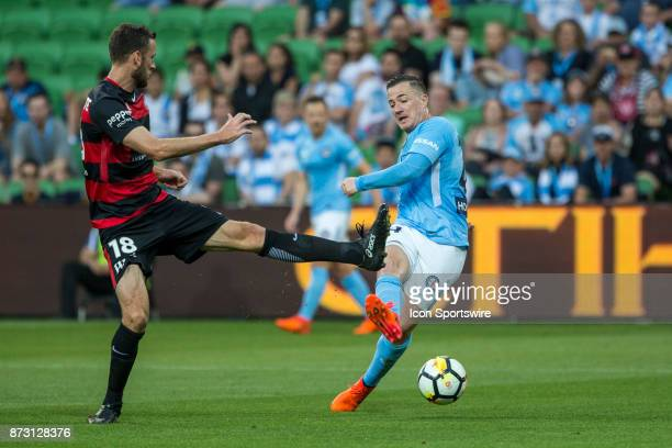 Ross McCormack of Melbourne City kicks the ball towards goal while Robert Cornthwaite of the Western Sydney Wanderers attempts to block the shot...