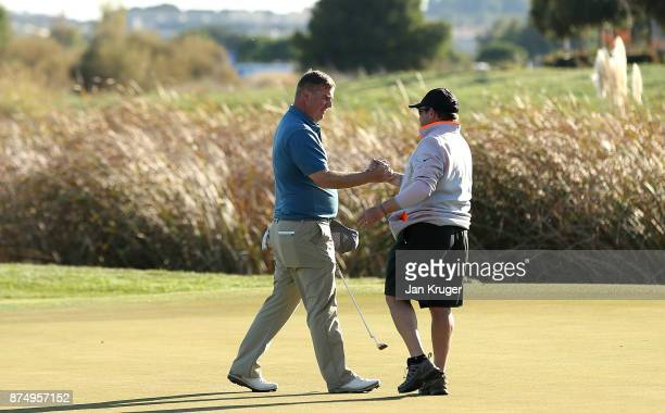 Ross McGowan of England celebrates earning his card with his caddie during the final round of the European Tour Qualifying School Final Stage at...