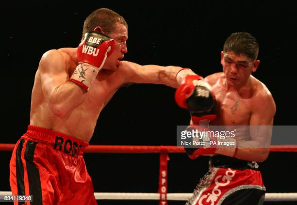Ross Minter lands left to Michael Jennings in action during the WBU Welterweight Title bout at ExCel Arena London