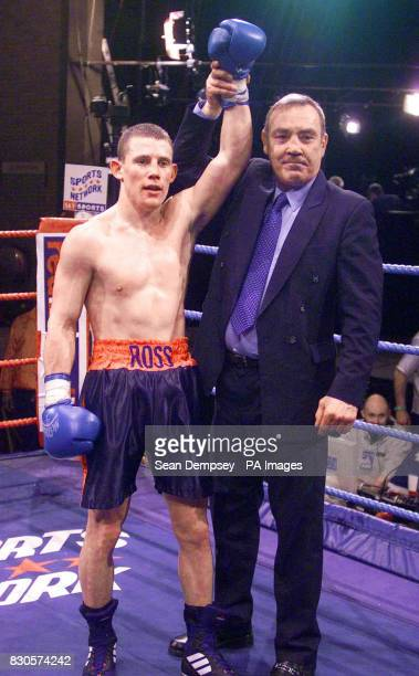 Ross Minter takes the salute with his father former world middleweight champion Alan Minter after he beat on points Brian Coleman in a welterweight...