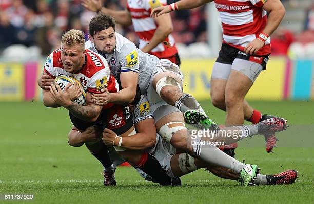 Ross Moriarty of Gloucester is tackled by Elliott Stooke and Charlie Ewels during the Aviva Premiership match between Gloucester and Bath at...