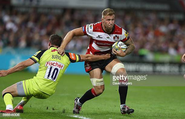 Ross Moriarty of Gloucester is tackled by Freddie Burns during the Aviva Premiership match between Gloucester and Leicester Tigers at Kingsholm...