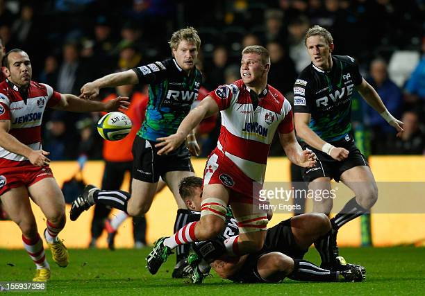 Ross Moriarty of Gloucester offloads the ball as he is tackled during the LV= Cup Round 1 match between Ospreys and Gloucester at the Liberty Stadium...