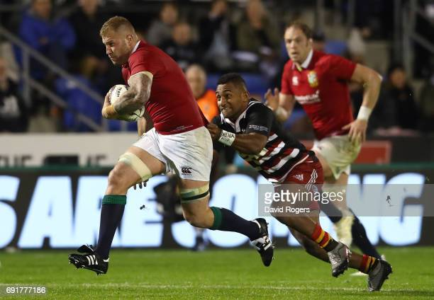 Ross Moriarty of the British Irish Lions charges upfield whilst Sevu Reece of NZ Provincial Barbarians attempts a tackle during the 2017 British...