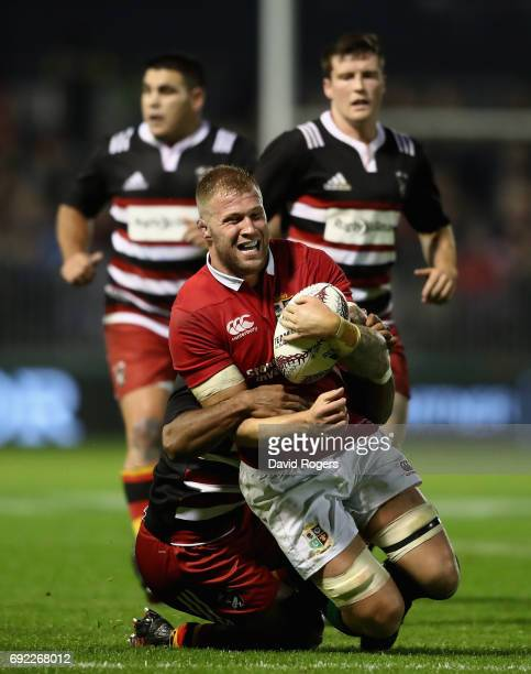 Ross Moriarty of the Lions is tackled during the match between the New Zealand Provincial Barbarians and the British Irish Lions at Toll Stadium on...