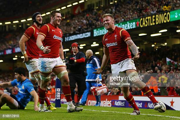 Ross Moriarty of Wales celebrates after scoring his team's seventh try during the RBS Six Nations match between Wales and Italy at the Principality...
