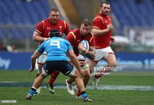 Ross Moriarty of Wales charges into Edoardo Gori of Italy during the RBS Six Nations match between Italy and Wales at the Stadio Olimpico on February...