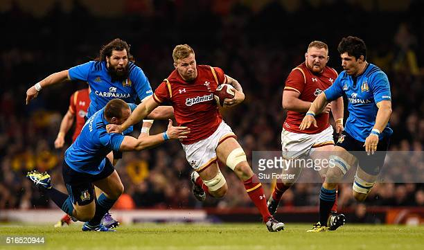 Ross Moriarty of Wales races away from a tackle as Martin Castrogiovanni looks on during the RBS Six Nations match between Wales and Italy at the...