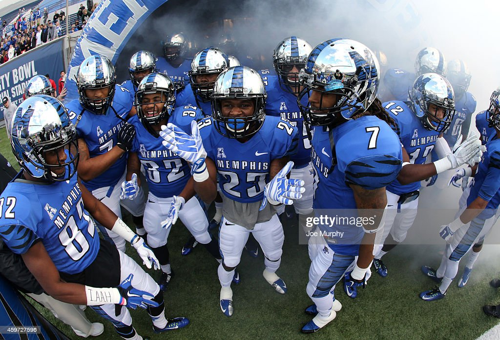 J Ross of the Memphis Tigers prepares to take the field with his teammates before a game against the Connecticut Huskies on November 29 2014 at...