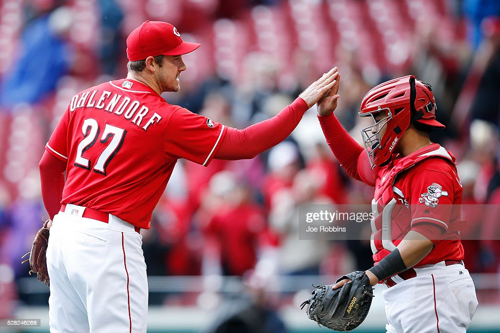 Ross Ohlendorf #27 and Ramon Cabrera #37 of the Cincinnati Reds celebrate after the final out of the game against the San Francisco Giants at Great American Ball Park on May 4, 2016 in Cincinnati, Ohio. The Reds defeated the Giants 7-4.
