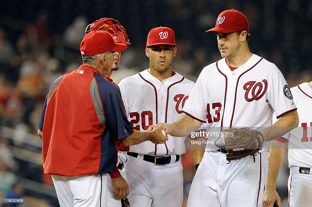 <a gi-track='captionPersonalityLinkClicked' href=/galleries/search?phrase=Ross+Ohlendorf&family=editorial&specificpeople=4172563 ng-click='$event.stopPropagation()'>Ross Ohlendorf</a> #43 of the Washington Nationals is taken out of the game by manager Davey Johnson #5 in the sixth inning against the Miami Marlins at Nationals Park on August 27, 2013 in Washington, DC.