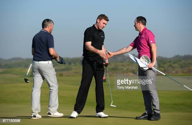 Ross Parker PGA Head of Sponsorship and James Holmes SkyCaddie UK and European Sales Manager shake hands at the end of their round on the 18th green...