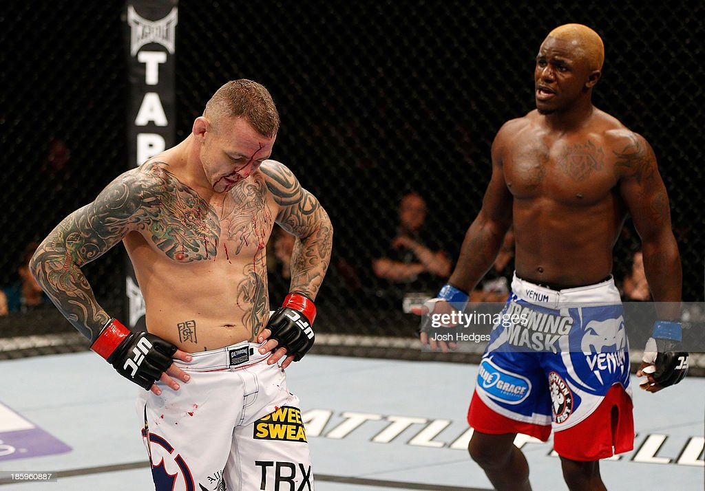 Ross Pearson and Melvin Guillard react after the doctor stopped their fight due to a cut suffered from an illegal knee by Guillard during the UFC Fight Night event at Phones 4 U Arena on October 26, 2013 in Manchester, England.