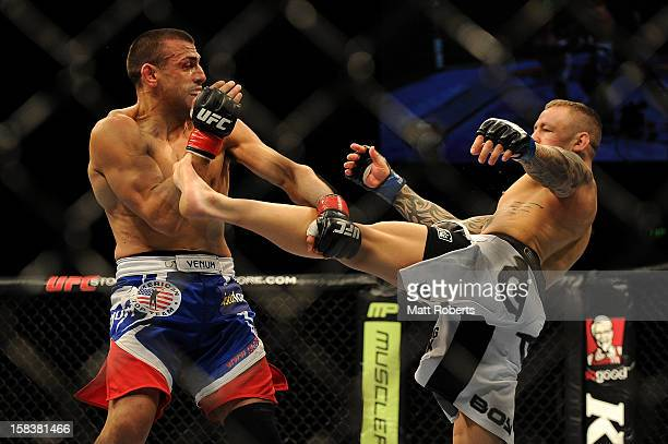 Ross Pearson kicks George Sotiropoulos during the Lightweight bout between George Sotiropoulos and Ross Pearson at Gold Coast Convention and...