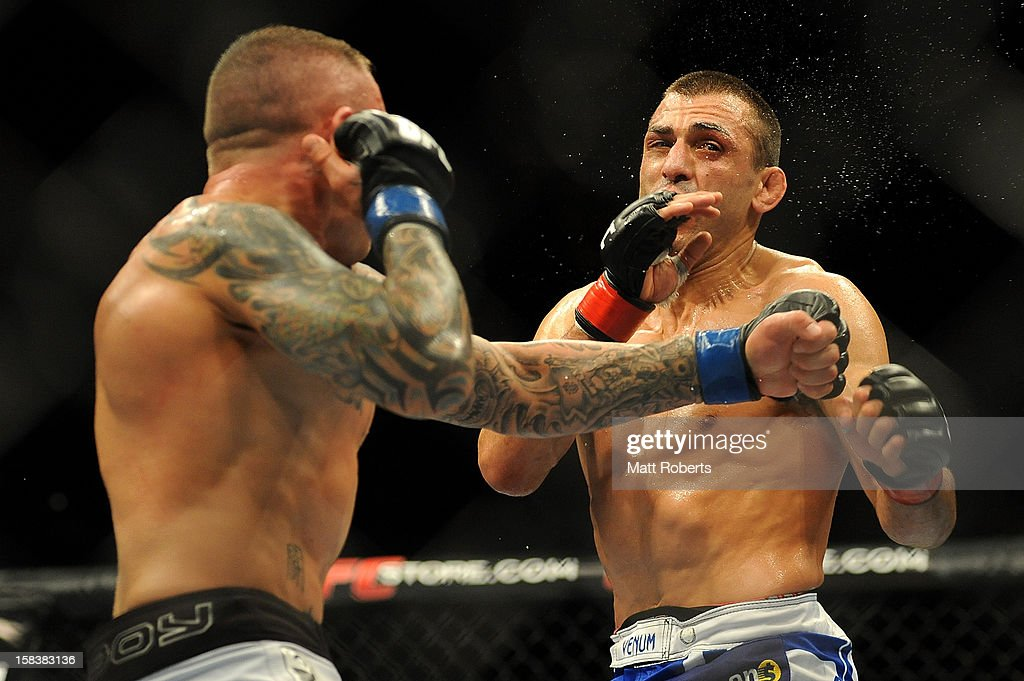 Ross Pearson punches <a gi-track='captionPersonalityLinkClicked' href=/galleries/search?phrase=George+Sotiropoulos&family=editorial&specificpeople=4691386 ng-click='$event.stopPropagation()'>George Sotiropoulos</a> (R) during the Lightweight bout between <a gi-track='captionPersonalityLinkClicked' href=/galleries/search?phrase=George+Sotiropoulos&family=editorial&specificpeople=4691386 ng-click='$event.stopPropagation()'>George Sotiropoulos</a> and Ross Pearson at Gold Coast Convention and Exhibition Centre on December 15, 2012 on the Gold Coast, Australia.