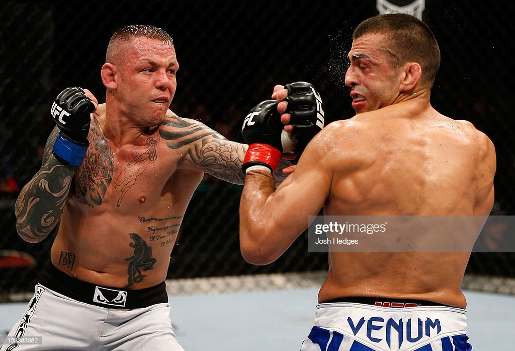 Ross Pearson punches <a gi-track='captionPersonalityLinkClicked' href=/galleries/search?phrase=George+Sotiropoulos&family=editorial&specificpeople=4691386 ng-click='$event.stopPropagation()'>George Sotiropoulos</a> during their lightweight fight at the UFC on FX event on December 15, 2012 at Gold Coast Convention and Exhibition Centre in Gold Coast, Australia.