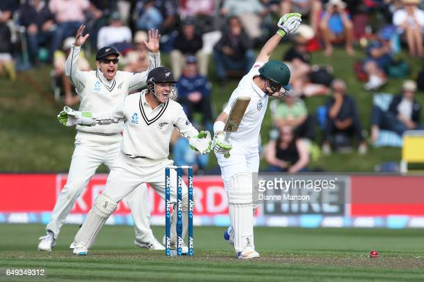 Ross Taylor and BJ Watling of New Zealand appeal for the dismissal of Dean Elgar of South Africa during day one of the First Test match between New...