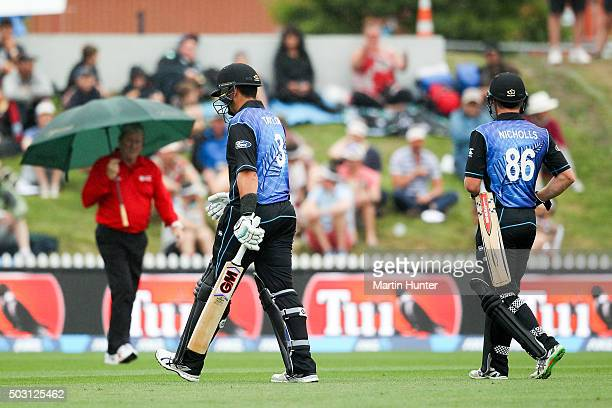 Ross Taylor and Henry Nicholls both of New Zealand leave the fielf dur to rain during games four of the One Day International Series between New...