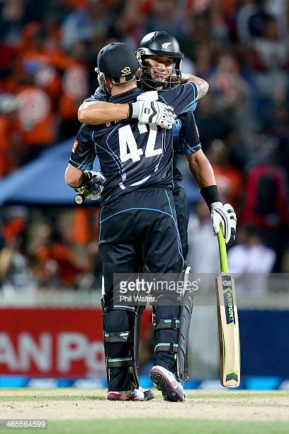 Ross Taylor of New Zealand and Brendon McCullum celebrate following game four of the men's one day international series between New Zealand and India...