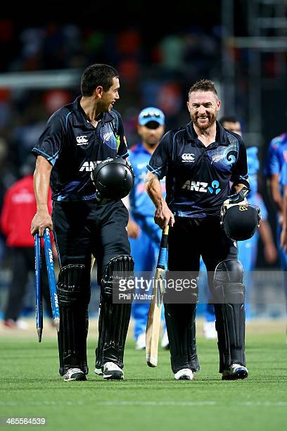 Ross Taylor of New Zealand and Brendon McCullum leave the field following game four of the men's one day international series between New Zealand and...
