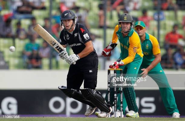 Ross Taylor of New Zealand bats as AB de Villiers of South Africa keeps wicket during the 2011 ICC World Cup quarter final match between New Zealand...