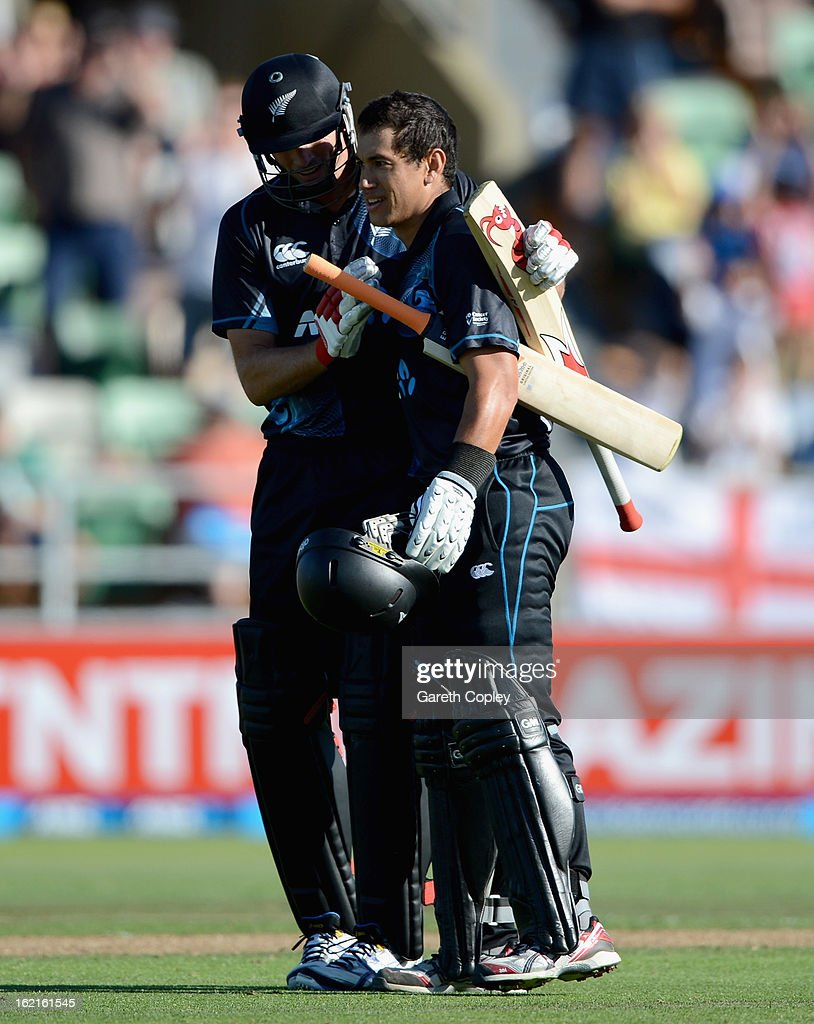 Ross Taylor of New Zealand celebrate with Kyle Mills after reaching his century during the second match of the international Twenty20 series between New Zealand and England at McLean Park on February 20, 2013 in Napier, New Zealand.